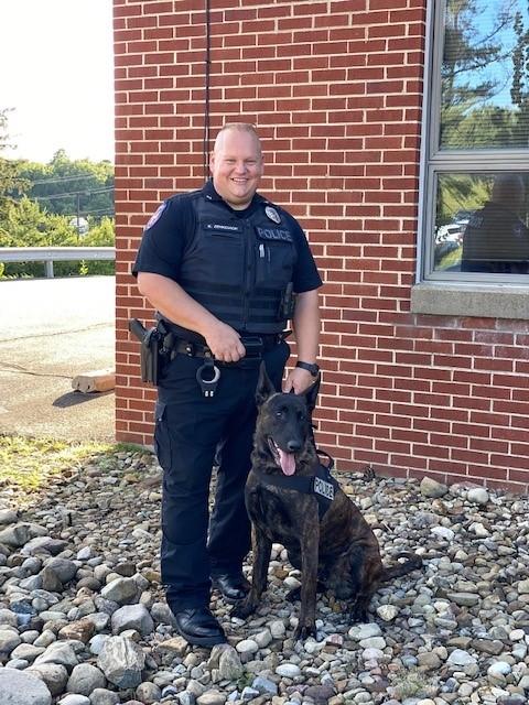 Tornado with his handler Officer Keith Zenkovich